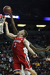 Davidson's Brian Sullivan (3) moves to the basket past Iowa's Gabriel Olaseni (0) during 2015 NCAA Division I Men's Basketball Championship March 20, 2015 at the Key Arena in Seattle, Washington.  Iowa beat Davidson 83-52.   ©2015. Jim Bryant Photo. ALL RIGHTS RESERVED.