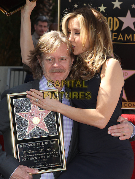 William H. Macy & Felictiy Huffman .Felictiy Huffman And William H. Macy Hollywood Walk Of Fame Induction Ceremony Held At On the Walk of Fame, Hollywood, California, USA.  .March 7th, 2012.half length moustache mustache facial hair married husband wife black suit dress suit profile kiss kissing .CAP/ADM/KB.©Kevan Brooks/AdMedia/Capital Pictures.