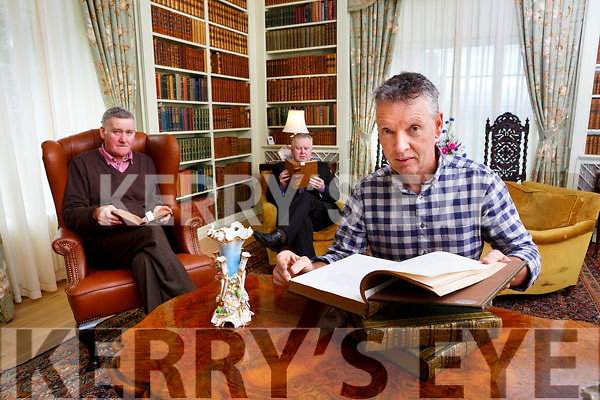 Paul Curtis Conservation bookbinder with Harry O'Donoghue third generation employee and Pat Dawson General Manager reading some of the 2000 leather bound books that have been restored  in the Kenmare Library at Killarney House