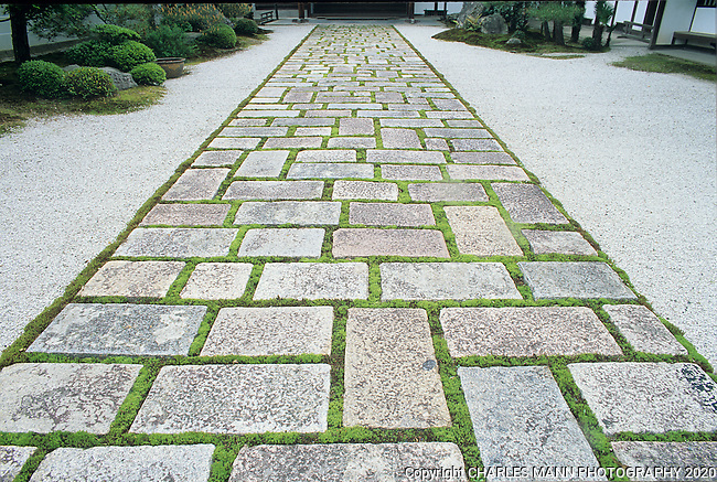 A paved walk near the temple of Nanzenji in the east side Okazaki district of Kyoto illustrate the simple elegance of organic style that Japanese gardens can elicit.