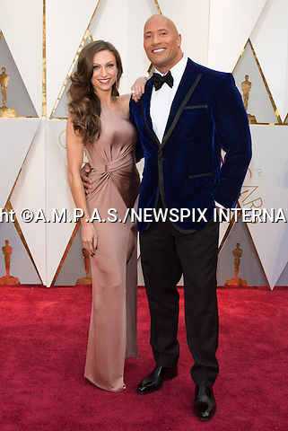 26.02.2017; Hollywood, USA: DWAYNE JOHNSON and LAUREN HASHIAN <br /> attends The 89th Annual Academy Awards at the Dolby&reg; Theatre in Hollywood.<br /> Mandatory Photo Credit: &copy;AMPAS/NEWSPIX INTERNATIONAL<br /> <br /> IMMEDIATE CONFIRMATION OF USAGE REQUIRED:<br /> Newspix International, 31 Chinnery Hill, Bishop's Stortford, ENGLAND CM23 3PS<br /> Tel:+441279 324672  ; Fax: +441279656877<br /> Mobile:  07775681153<br /> e-mail: info@newspixinternational.co.uk<br /> Usage Implies Acceptance of Our Terms &amp; Conditions<br /> Please refer to usage terms. All Fees Payable To Newspix International