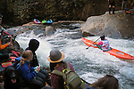 November 5, 2016 - Hendersonville, North Carolina.  A large crowd gathers for the action near the Scream Machine Rapids during to the 21st annual Green Race.The Green River Narrows provides one of the most intense and extreme whitewater venues in the world and is home to many of the USA's most talented paddlers.  Green River Narrows, Hendersonville, North Carolina.