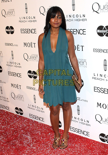 TATYANA ALI.The Third Annual ESSENCE Black Women In Hollywood Luncheon held at The Beverly Hills Hotel in Beverly Hills, California, USA. .March 4th, 2010 .full length dress clutch bag blue halterneck sleeveless plunging neckline .CAP/ADM/TC.©T. Conrad/AdMedia/Capital Pictures.