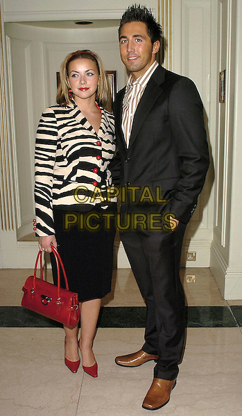 CHARLOTTE CHURCH & GAVIN HENSON.Children's Charity Ttrust Awards 2005 at the Grosvenor House Hotel, Park Lane, W1, London..September 28th, 2005.Ref: CAN.full length celebrity couple boyfriend grilfriend black suit skirt striped top red purse bag shoes.www.capitalpictures.com.sales@capitalpictures.com.©Capital Pictures