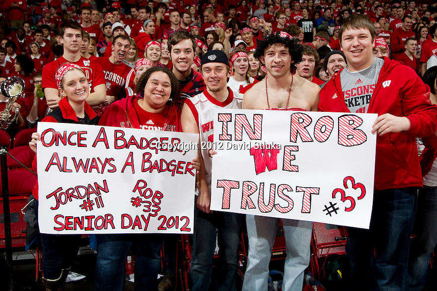 Wisconsin Badgers fans display homemade signs during a Big Ten Conference NCAA college basketball game against the Illinois Fighting Illini on Sunday, March 4, 2012 in Madison, Wisconsin. The Badgers won 70-56. (Photo by David Stluka)