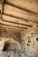 Picture & image of rock hall interiors with decorated ceilings Uplistsikhe (Lords Fortress) troglodyte cave city, near Gori, Shida Kartli, Georgia. UNESCO World Heritage Tentative List<br /> <br /> Inhabited from the early Iron age to the late middle ages Uplistsikhe cave city eas, during the Roman & Hellenistic period, home to around 20,000 people.