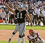 Oakland Raiders kicker Sebastian Janikowski (11) and punter Shane Lechler (9) celebrate game winning field goal on Sunday, September 14, 2003, in Oakland, California. The Raiders defeated the Bengals 23-20.