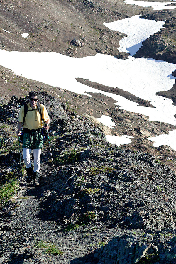 Man hiking on mountain ridge, Tomyhoi Peak, Yellow Aster Butte region, Whatcom County, North Cascades, Washington