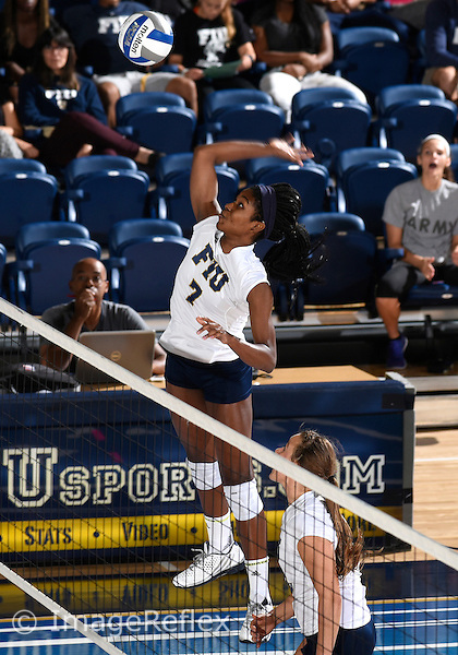 Florida International University women's volleyball middle blocker Jennifer Ene (7) plays against  the University of Central Florida which won the match 3-0 on September 17, 2015 at Miami, Florida.
