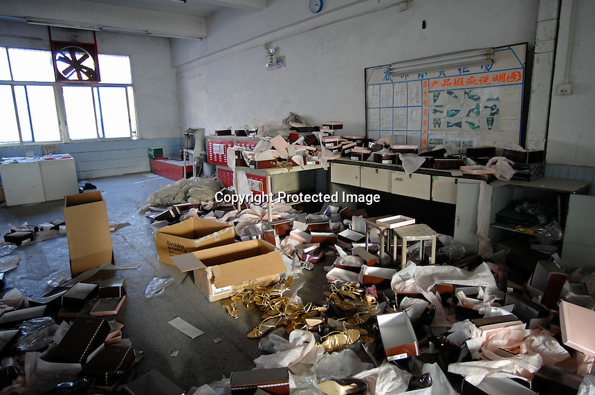 """The ransacked store-room of the  Dingfu Factory in Houjie Town, Donguan, China.  A sign outside the factory that made shoes for Zara and Nine West amongst others, reads that the """"Donguan People's Court have closed the factory"""" .  As the economy changes and Chinese labour gets more expensive, factories are cosing leaving ghost towns behind them.<br /> <br /> MUST CREDIT PHOTO BY RICHARD JONES/SINOPIX"""
