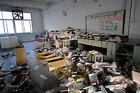 "The ransacked store-room of the  Dingfu Factory in Houjie Town, Donguan, China.  A sign outside the factory that made shoes for Zara and Nine West amongst others, reads that the ""Donguan People's Court have closed the factory"" .  As the economy changes and Chinese labour gets more expensive, factories are cosing leaving ghost towns behind them.<br /> <br /> MUST CREDIT PHOTO BY RICHARD JONES/SINOPIX"
