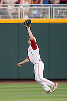 North Carolina State outfielder Brett Williams (3) makes a catch during Game 10 of the 2013 Men's College World Series against the North Carolina Tar Heels on June 20, 2013 at TD Ameritrade Park in Omaha, Nebraska. The Tar Heels defeated the Wolfpack 7-0, eliminating North Carolina State from the tournament. (Andrew Woolley/Four Seam Images)