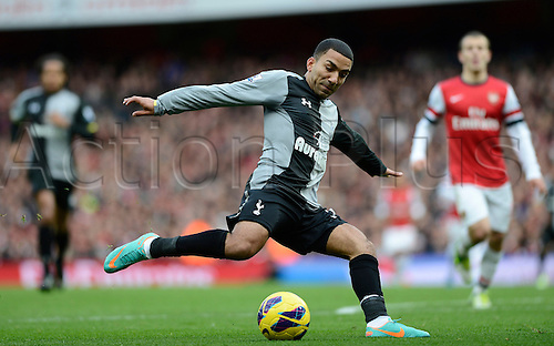 17.11.2012. London, England. Jack Wilshere Of Arsenal watches as Aaron Lennon of Tottenham crosses the ball during the Premier League game between Arsenal and Tottenham Hotspur from the Emirates Stadium.