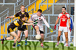 Rathmore keeper Padraig McCarthy  clears the danger from Dr Crokes Jordan Kiely as Kerry legends Colm Cooper and Tom O'Sullivan look on during the County Championship QF in Fitzgerald Stadium on Sunday