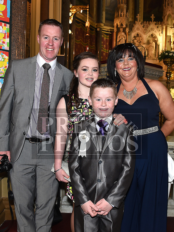 Alan Campbell who received his First Holy Communion in St. Peters Church pictured with parents Peter and Wendy and sister Megan. Photo:Colin Bell/pressphotos.ie