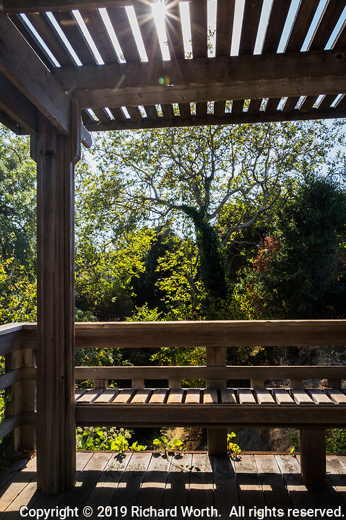 A skillfully crafted wooden Japanese Garden structure offers an opportunity to sit and contemplate.