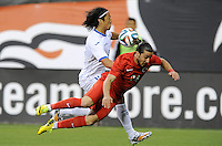 Washington, D.C.- May 29, 2014. Turkey defender Tarik Camdal gets fouled by Honduras midfielder Roger Ezpinoza.  Turkey defeated Honduras 2-0 during an international friendly game at RFK Stadium.