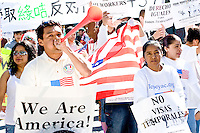 People gather at Roosevelt Park, one of several meeting spots for protesters of United States immigration policy in New York City on May 1, 2006.