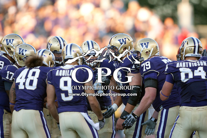 Sept 3, 2011:  Washington offensive players huddle during a timeout on the field against Eastern Washington.  Washington defeated Eastern Washington 30-27 at Husky Stadium in Seattle, Washington...