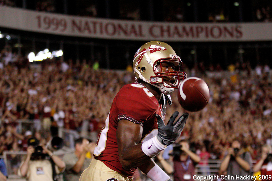 TALLAHASSEE, FL 10/10/09-FSU-Ga. Tech FB09 CH29-Florida State's Jarmon Fortson releases the ball after catching the Seminole's fourth touchdown against Georgia Tech during first half action Saturday at Doak Campbell Stadium in Tallahassee. .COLIN HACKLEY PHOTO