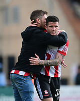 A fan hugs Lincoln City's Billy Knott after the Imps second goal<br /> <br /> Photographer Chris Vaughan/CameraSport<br /> <br /> Vanarama National League - Lincoln City v Macclesfield Town - Saturday 22nd April 2017 - Sincil Bank - Lincoln<br /> <br /> World Copyright &copy; 2017 CameraSport. All rights reserved. 43 Linden Ave. Countesthorpe. Leicester. England. LE8 5PG - Tel: +44 (0) 116 277 4147 - admin@camerasport.com - www.camerasport.com