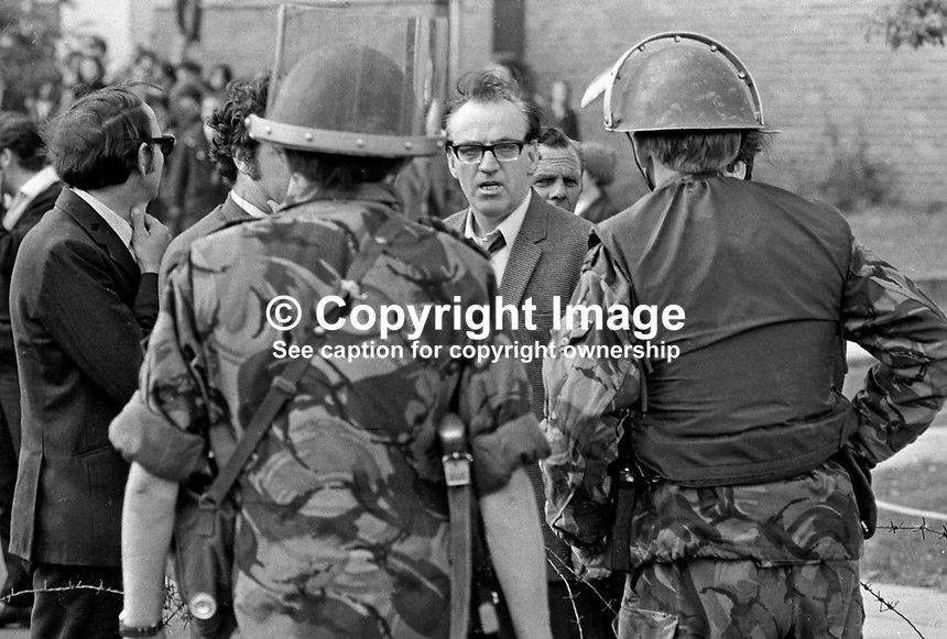 Seamus Twomey, leader, Provisional IRA in Belfast, in a verbal confrontation with British soldiers in Lenadoon on the outskirts of Belfast. The dispute concerned the rehousing of displaced Roman Catholics in a traditionally Protestant area. Shortly afterwards IRA gunmen opened fire on British soldiers and brought the then ceasefire to an end. Only two days earlier on 7 July 1972 Seamus Twomey was in London as a member of an IRA delegation meeting senior members of the UK government. 197207090425.<br /> <br /> Copyright Image from Victor Patterson, 54 Dorchester Park, <br /> Belfast, UK, BT9 6RJ<br /> <br /> t1: +44 28 9066 1296 (from Rep of Ireland 048 9066 1296)<br /> t2: +44 28 9002 2446 (from Rep of Ireland 048 9002 2446)<br /> m: +44 7802 353836<br /> <br /> e: victorpatterson@me.com<br /> www.victorpatterson.com<br /> <br /> Please see my Terms and Conditions of Use at www.victorpatterson.com. It is IMPORTANT that you familiarise yourself with them.<br /> <br /> Images used on the Internet must be visibly watermarked i.e. &copy; Victor Patterson<br /> within the body of the image and copyright metadata must not be deleted. Images <br /> used on the Internet have a size restriction of 4kbs and will be chargeable at current<br />  NUJ rates unless agreed otherwise.<br /> <br /> This image is only available for the use of the download recipient i.e. television station, newspaper, magazine, book publisher, etc, and must not be passed on to any third <br /> party. It is also downloaded on condition that each and every usage is notified within 7 days to victorpatterson@me.com<br /> <br /> The right of Victor Patterson to be identified as the author is asserted in accordance with The Copyright Designs And Patents Act (1988). All moral rights are asserted