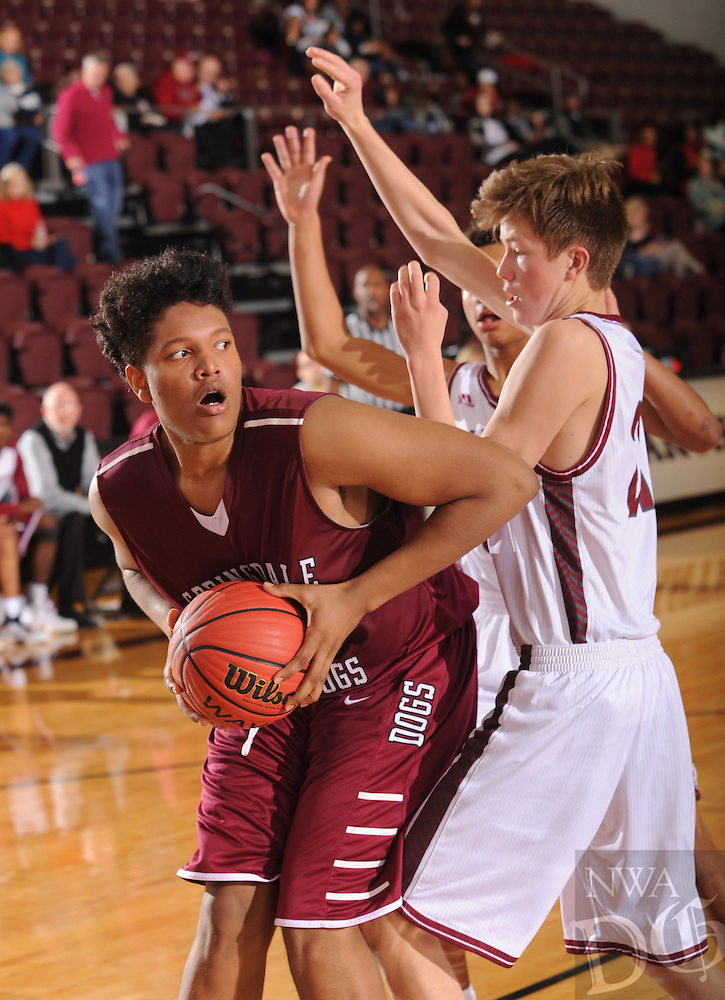 NWA Democrat-Gazette/ANDY SHUPE<br /> Ishine McFarlane (right) of Springdale makes a post move around Luke Fox (left) of Tulsa (Okla.) Holland Hall Tuesday. Dec. 29, 2015, during the second half at Siloam Springs High School. Visit nwadg.com/photos to see more photographs from the game.