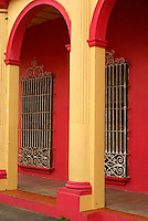 Arches and wrought iron windows in the Spanish colonial river town of Tlacotalpan, Veracruz, Mexico. Tlacotlapan was made a UNESCO World Heritage Site in 1998.