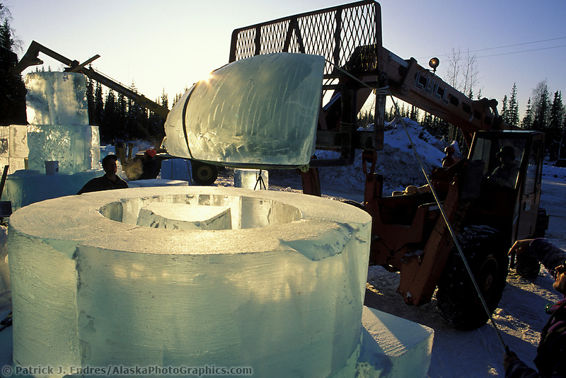 Construction of ice sculpture at the World Ice Sculpting Championships in Fairbanks, Alaska