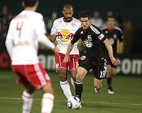 Chris Pontious (13) of D.C. United races away from Tierry Henry (14) of the New York Red Bulls during an MLS match at RFK Stadium, in Washington D.C. on April 21 2011. Red Bulls won 4-0.