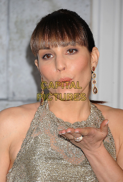 Noomi Rapace.The World Premiere of 'Sherlock Holmes: A Game of Shadows' held at The Village Theatre in Brentwood, California, USA..December 6th, 2011.headshot portrait silver beads beaded sleeveless fringe bangs hair dangling gold earrings hand ring blowing kiss.CAP/ROT/TM.©Tony Michaels/Roth Stock/Capital Pictures