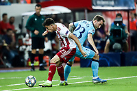 Christian Eriksen of Tottenham Hotspur in action with Kostas Tsimikas of Olympiacos Fc, during the UEFA Champions League match between Olympiacos Fc and Tottenham Hotspur, in Karaiskaki Stadium in Piraeus, Greece. Wednesday 18 September 2019