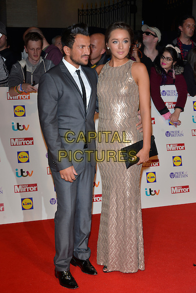 Peter Andre and Emily MacDonagh<br /> The Daily Mirror's Pride of Britain Awards arrivals at the Grosvenor House Hotel, London, England.<br /> 7th October 2013<br /> full length dress silver gold sleeveless grey gray suit pregnant couple black clutch bag profile <br /> CAP/PL<br /> &copy;Phil Loftus/Capital Pictures