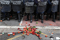 Pictured: Fresh produce is placed in front of riot police by the farmers Friday 12 February 2016<br />