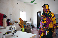Komola Begum, 43,  survived the collapse of Rana Plaza on April 24, 2013. Shirin and another four survivors now work in a model garment factory called 'Oporajeo', a worker-owned factory in Savar, near Dhaka, Bangladesh