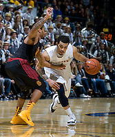 Justin Cobbs of California dribbles during the game against USC at Haas Pavilion in Berkeley, California on February 17th, 2013.  California defeated USC, 76-68.