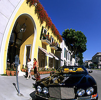 Rodeo Drive shopping in upscale Beverly Hills Hollywood Los Angeles California with Bentley parked in fron
