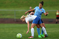 Piscataway, NJ, May 13, 2016. Midfielder McCall Zerboni (77) of the Boston Breakers shields the ball from forward Raquel Rodriguez (11) of Sky Blue FC.  Sky Blue FC defeated the Boston Breakers, 1-0, in a National Women's Soccer League (NWSL) match at Yurcak Field.