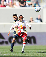 Roger Torres #20 of the Philadelphia Union races up behind Dane Ricards #19 of the New York RedBulls during a MLS  match on April 24 2010, at RedBull Arena, in Harrison, New Jersey.