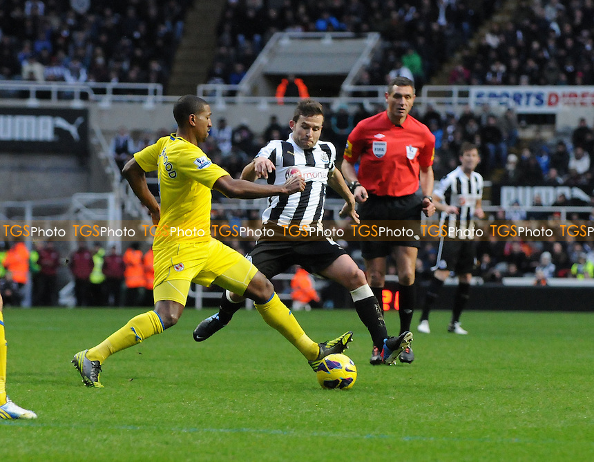 Newcastle United midfielder Yohan Cabaye battles with Mikele Leigertwood of Reading - Newcastle United vs Reading - Barclays Premier League Football at St James Park, Newcastle upon Tyne - 19/01/13 - MANDATORY CREDIT: Steven White/TGSPHOTO - Self billing applies where appropriate - 0845 094 6026 - contact@tgsphoto.co.uk - NO UNPAID USE.