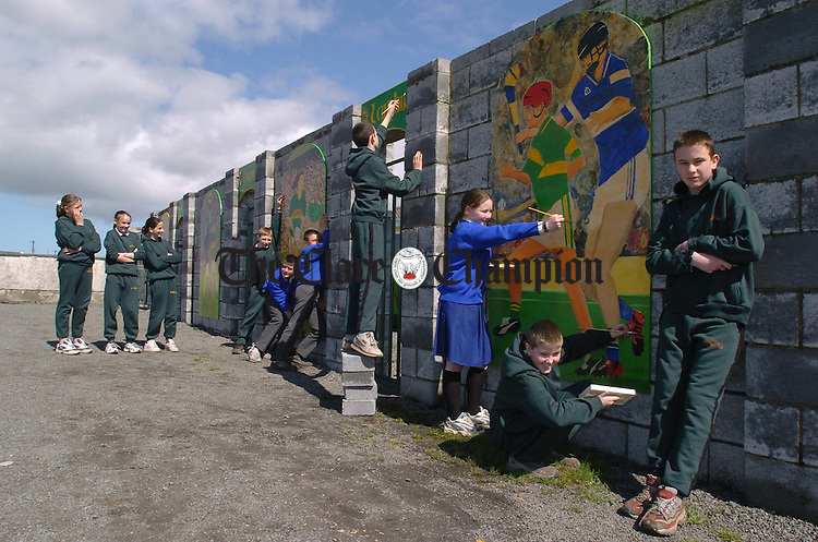 Sixth class pupils of Kilmihil national school putting the finishing touches to their entry for this year's ESB Enhancing Your Environment competition. The murals are done on the wall of the GAA pitch which is adjacent to the school. Photograph by John Kelly.