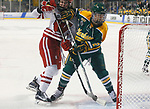 ST CHARLES, MO - MARCH 19:  Corie Jacobson (2) of the Clarkson Golden Knights battles for position in front of the Wisconsin net during the Division I Women's Ice Hockey Championship held at The Family Arena on March 19, 2017 in St Charles, Missouri. Clarkson defeated Wisconsin 3-0 to win the national championship. (Photo by Mark Buckner/NCAA Photos via Getty Images)