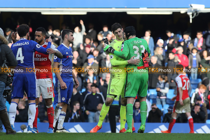 Chelsea goalkeeper, Thibaut Courtois and Arsenal's Petr Cech embrace at the final whistle during Chelsea vs Arsenal, Premier League Football at Stamford Bridge on 4th February 2017