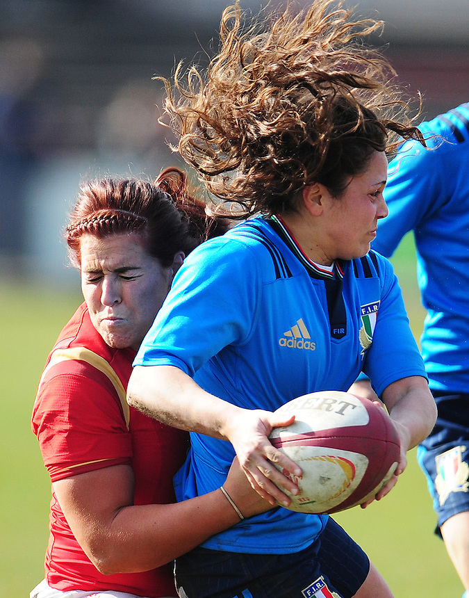 Italy&rsquo;s Mariagrazia Cioffi is tackled by Wales&rsquo; Keira Bevan<br /> <br /> Photographer Kevin Barnes/CameraSport<br /> <br /> International Women's Rugby Union - RBS Women's Six Nations Championships 2016 Round 5 - Wales Women v Italy Women - Sunday 20th March 2016 - Aberavon RFC, Port Talbot<br /> <br /> &copy; CameraSport - 43 Linden Ave. Countesthorpe. Leicester. England. LE8 5PG - Tel: +44 (0) 116 277 4147 - admin@camerasport.com - www.camerasport.com
