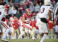 NWA Democrat-Gazette/CHARLIE KAIJO Arkansas running back Devwah Whaley (21) carries the ball Saturday, November 2, 2019 during the third quarter of a football game at Donald W. Reynolds Razorback Stadium in Fayetteville. Visit nwadg.com/photos to see more photographs from the game.