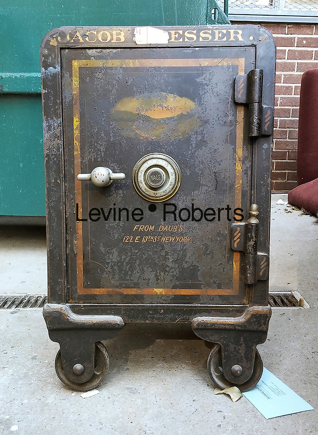 A safe is seen in the trash area of an apartment building in New York on Wednesday, March 2, 2016. (© Richard B. Levine)