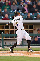 Tyler Saladino (8) of the Charlotte Knights follows through on his swing against the Gwinnett Braves at BB&T Ballpark on April 16, 2014 in Charlotte, North Carolina.  The Braves defeated the Knights 7-2.  (Brian Westerholt/Four Seam Images)