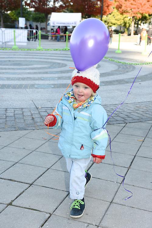 A toddler with a balloon