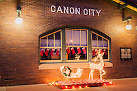 An intricate wire mesh Rudolf and sleigh mark the holiday season outside the railroad station in Cañon City, Colorado.
