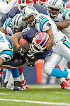 Buffalo Bills runningback Willis McGahee (21) is tackled by linebacker Chris Draft (52) rushing against the Carolina Panthers on November 27, 2005 at Ralph Wilson Stadium in Orchard Park, NY. The Panthers defeated the Bills 13-9. Mandatory Photo Credit: Ed Wolfstein